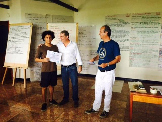 Ecuadorian student Paul Medranda receives Mangrove Finch Conservation Workshop participation certificate from CCREG Director Eliécer Cruz and CDF Executive Director Dr Arturo Izurieta.