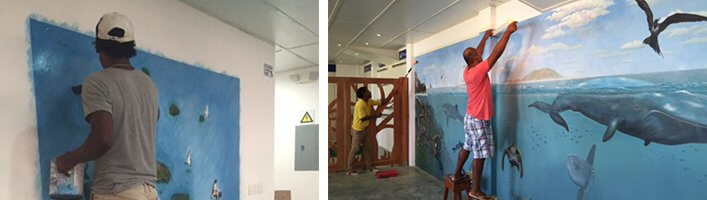 Local artists painting the 'Charles Darwin' Exhibition Hall
