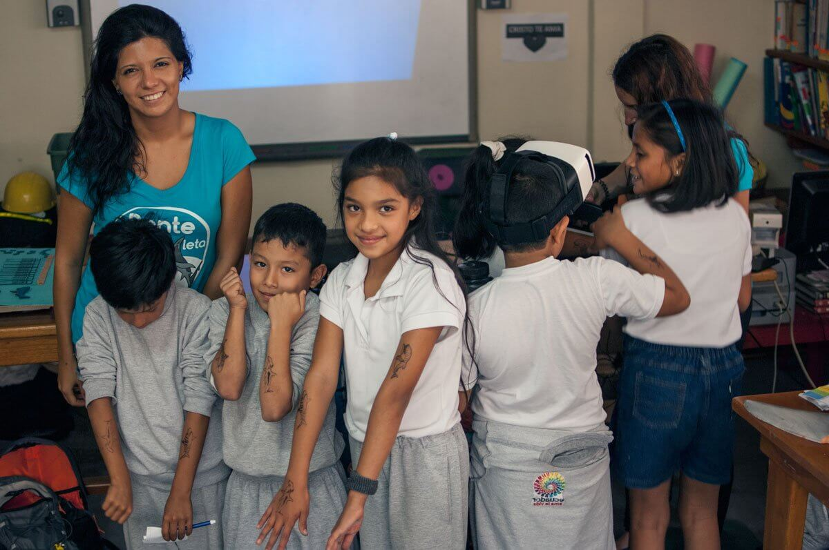 Daniela Vilema and Beatriz Mariño with children after shark workshop.