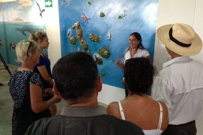 Visitors to the Charles Darwin Exhibition Hall, hear a talk about the marine biodiversity in the Galapagos.