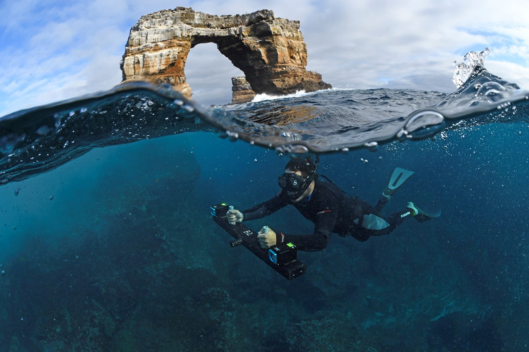 Dr. Pelayo Salinas de León with the DOVs underwater camera system at Darwin's Arch.