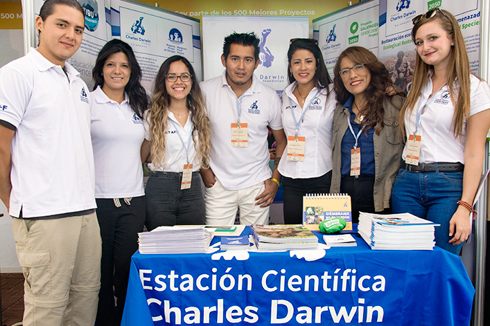 CDF stand with the representatives of Galápagos Verde, Shark Ambassadors and Mangrove Finch projects.