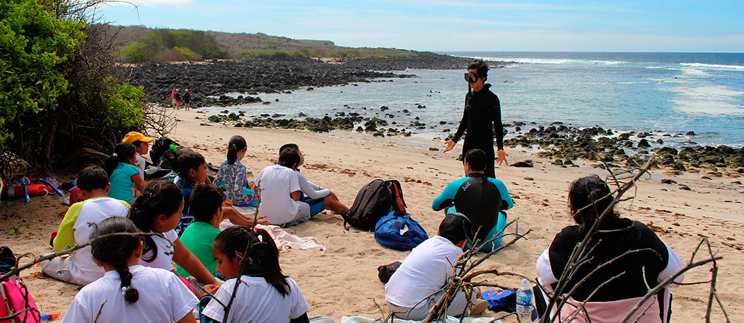 Snorkeling class with Alejandro Alvear school students in San Cristobal Island