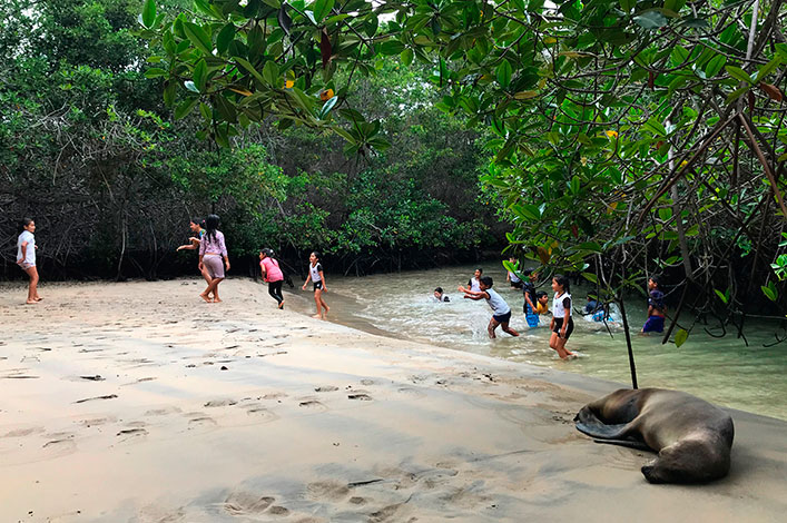 "Students from the Stella Maris school from Isabela Island enjoying in ""El Estero"" after of the walk through the wetlands"