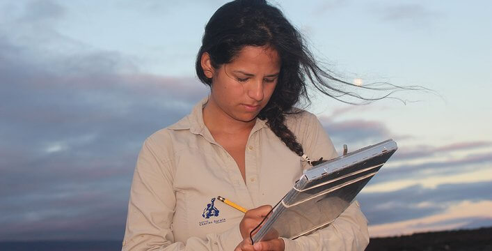 The scholarship grantee, Diana Carolina Loyola taking notes in the field.
